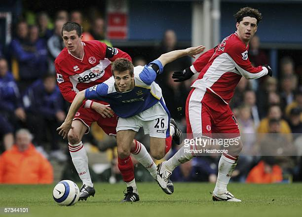 Gary O'Neil of Portsmouth is surrounded by Fabio Rochemback and Andrew Taylor of Middlesbrough during the Barclays Premiership match between...