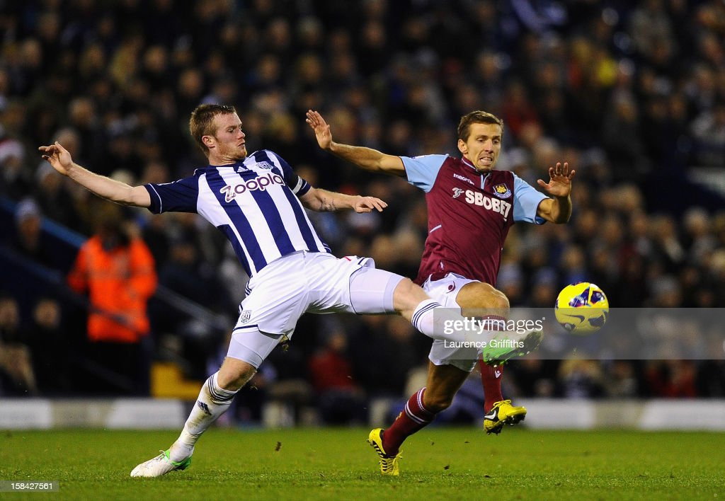 Gary O'Neil of West Ham United battles with Chris Brunt of West Bromwich Albion during the Barclays Premiership match between West Bromwich Albion and West Ham United at The Hawthorns on December 16, 2012 in West Bromwich, England.