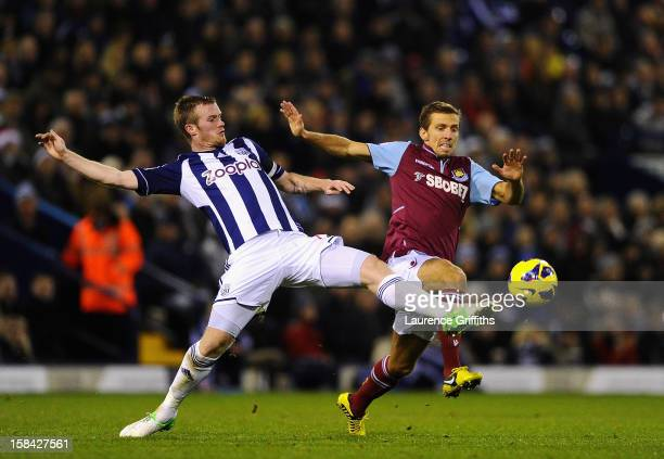 Gary O'Neil of West Ham United battles with Chris Brunt of West Bromwich Albion during the Barclays Premiership match between West Bromwich Albion...