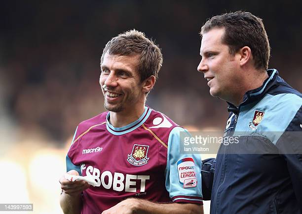 Gary O'Neil of West Ham United shares a joke with medical staff during the nPower Championship Playoff Semi Final 2nd Leg between West Ham United and...