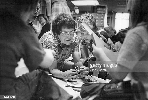 DEC 1973 JAN 8 1974 Gary Ostwald Fart Morgan gets some help with a handicraft project from Mrs Dortch during the story hour She began summer reading...