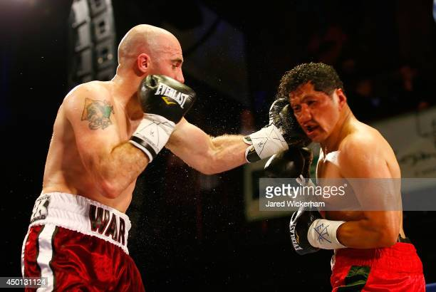 Gary O'Sullivan lands a punch on Jose Medina during their super middleweight bout at the House of Blues on June 5, 2014 in Boston, Massachusetts.