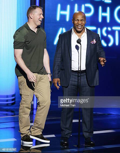 Gary Owen and Mike Tyson speak onstage during the 'BET AWARDS' 14 held at Nokia Theater LA LIVE on June 29 2014 in Los Angeles California