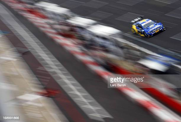 Gary Paffett of Great Britain and EURONICS Mercedes AMG drives during the qualifying for the second round of the DTM 2013 German Touring Car...