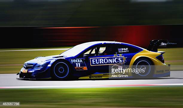 Gary Paffett of Great Britain and Mercedes HWA drives during the training session ahead of qualifying for the fifth round of the DTM German Touring...
