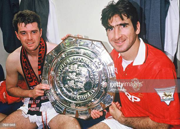 Gary Pallister and Eric Cantona celebrate in the dressing room after the Arsenal v Manchester United Charity Shield match at Wembley Stadium London...