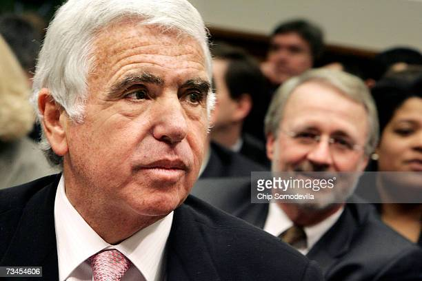 Gary Parsons Chairman of XM Satellite Radio sits behind Mel Karmazin CEO of SIRIUS Satellite Radio before he testifies during the House Judiciary...