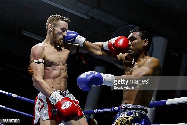 Gary Patterson trades blows with Phisit Suksawang during their professional Muay Thai bout on May 21 2016 in Sydney Australia Phisit went on to win...