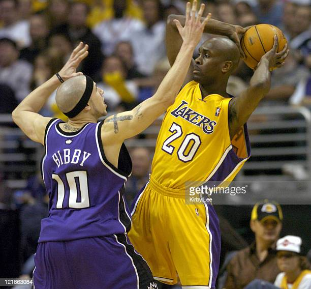 Gary Patyon of the Los Angeles Lakers is guarded by Mike Bibby of the Sacramento Kings during the game between the Sacramento Kings and the Los...