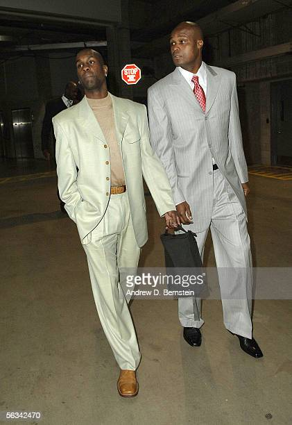 Gary Payton and Antoine Walker of the Miami Heat walk to the locker room before the game against the Los Angeles Clippers on December 5 2005 at...