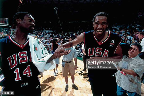 Gary Payton and Vince Carter of the United States National Team high five against the United States Select Team during a pre-Olympic exhibition game...