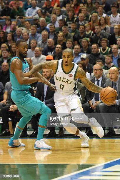 Gary Payton II of the Milwaukee Bucks drives around Kemba Walker of the Charlotte Hornets during the first half of a game at the BMO Harris Bradley...