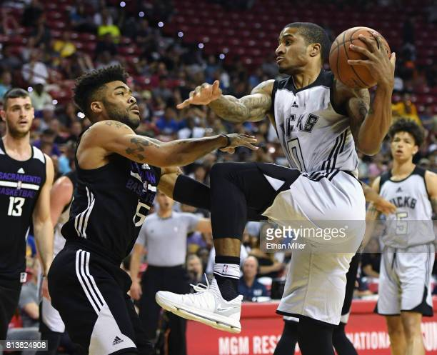 Gary Payton II of the Milwaukee Bucks drives to the basket against Frank Mason III of the Sacramento Kings during the 2017 Summer League at the...