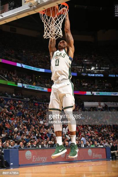 Gary Payton II of the Milwaukee Bucks dunks the ball against the New Orleans Pelicans on December 13 2017 at Smoothie King Center in New Orleans...
