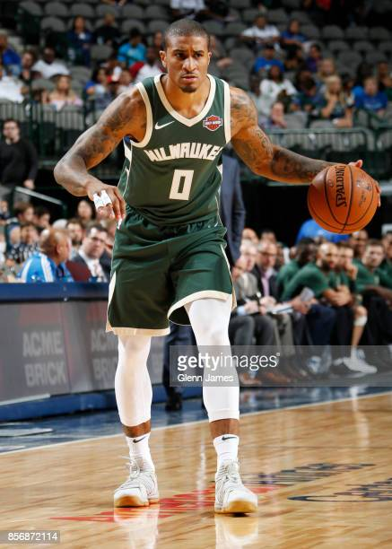Gary Payton II of the Milwaukee Bucks handles the ball against the Dallas Mavericks during the preseason game on October 2 2017 at the American...
