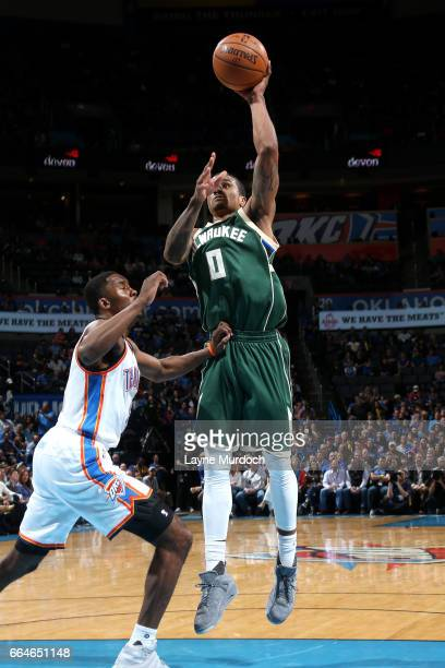 Gary Payton II of the Milwaukee Bucks shoots the ball during the game against the Oklahoma City Thunder on April 4 2017 at Chesapeake Energy Arena in...