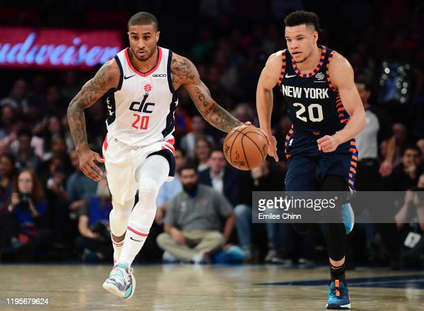 Gary Payton II of the Washington Wizards drives past Kevin Knox II of the New York Knicks during the first half of their game at Madison Square...
