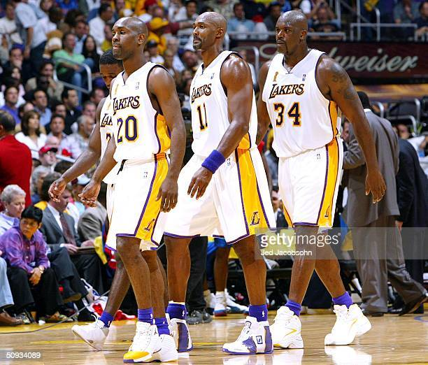 Gary Payton Kareem Rush Karl Malone and Shaquille O'Neal of the Los Angeles Lakers walk off the court in Game 1 of the 2004 NBA Finals against the...