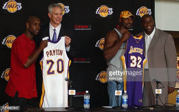 Gary Payton Lakers general manager Mitch Kupchak Karl Malone and Lakers vice president Magic Johnson at Staples Center press conference to announce...
