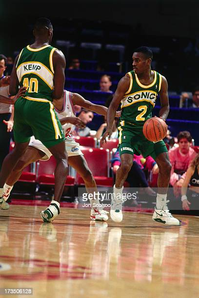 Gary Payton looks to drive off of a pick set by teammate Shawn Kemp of the Seattle SuperSonics during a game against the Los Angeles Clippers played...