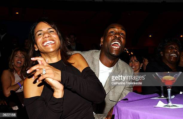 Gary Payton of the Los Angeles Lakers and his wife Monique having a good laugh at the Shaq hosting a night of preseason party to benefit the Lakers...
