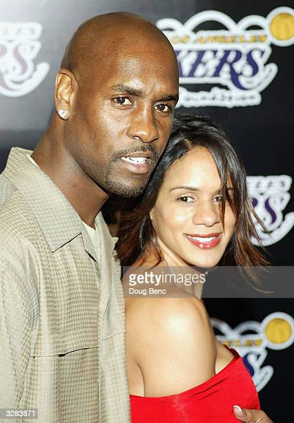 Gary Payton of the Los Angeles Lakers and Wife Monique arrive for the 1st Annual Palms Casino Royale to benefit the Los Angeles Lakers Youth...