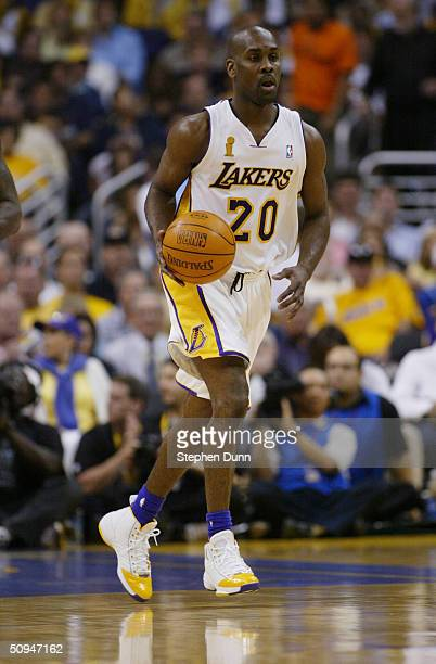 Gary Payton of the Los Angeles Lakers drives against the Detroit Pistons in Game One of the 2004 NBA Finals at Staples Center on June 6 2004 in Los...