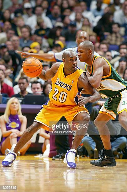 Gary Payton of the Los Angeles Lakers posts up Ray Allen of the Seattle Sonics during the game at the Staples Center on March 5, 2004 in Los Angeles,...