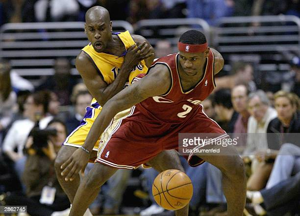 Gary Payton of the Los Angeles Lakers puts pressure on LeBron James of the Cleveland Cavaliers on January 12 2004 at Staples Center in Los Angeles...