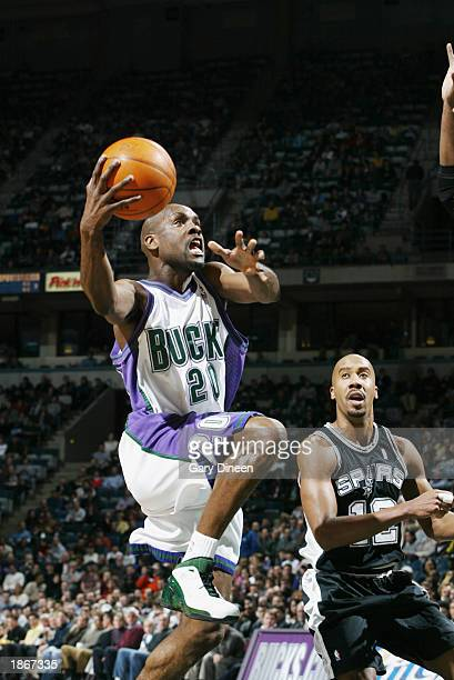 Gary Payton of the Milwaukee Bucks shoots past Bruce Bowen of the San Antonio Spurs during the game at Bradley Center on March 11 2003 in Milwaukee...
