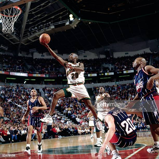Gary Payton of the Seattle Sonics drives to the basket during an NBA game against the Houston Rockets on February 14, 1997 at Key Arena in Seattle,...
