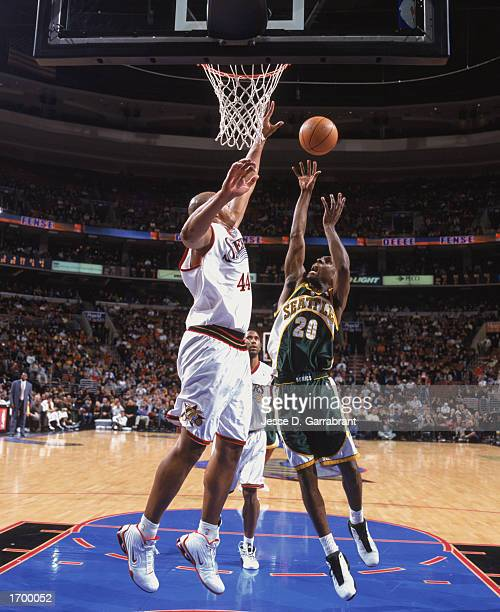 Gary Payton of the Seattle Sonics puts up a shot against Derrick Coleman of the Philadelphia 76ers at First Union Center on December 11, 2002 in...