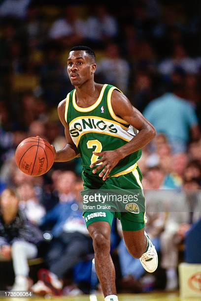 Gary Payton of the Seattle SuperSonics advances the ball against the Los Angeles Lakers during a game played at the Great Western Forum in Los...