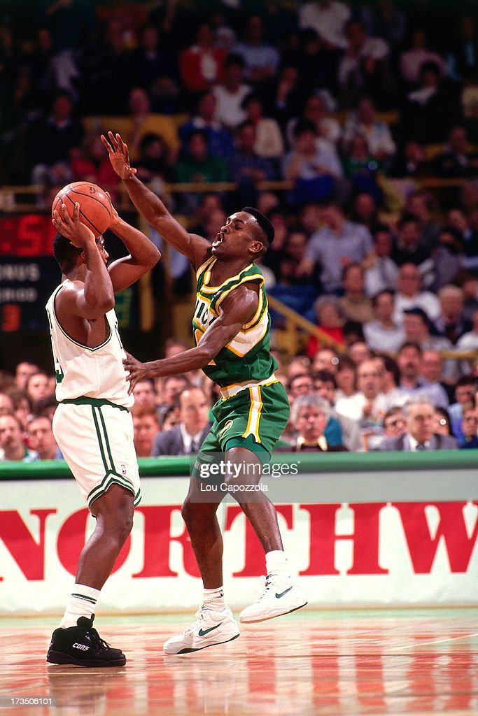 Gary Payton #2 of the Seattle SuperSonics defends against the Boston Celtics during a game played at the Boston Garden in Boston Massachusetts circa 1991.