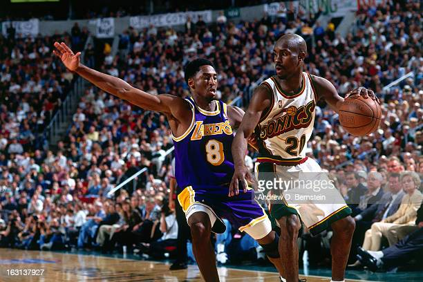 Gary Payton of the Seattle Supersonics dribbles the ball against Kobe Bryant of the Los Angeles Lakers in Game Five of the Western Conference...