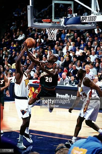 Gary Payton of the Seattle SuperSonics drives to the basket against the Golden State Warriors at The Arena at Oakland during a 1999 season NBA game...