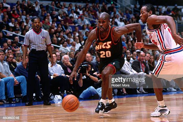 Gary Payton of the Seattle Supersonics drives to the basket against the Los Angeles Clippers on November 2 2000 at Staples Center in Los Angeles CA...