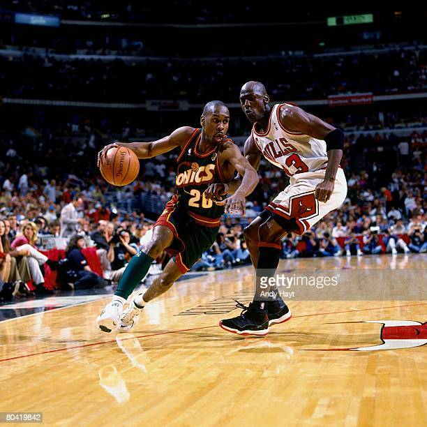 Gary Payton of the Seattle SuperSonics drives to the basket against Michael Jordan of the Chicago Bulls during Game Six of the 1996 NBA Finals at the...