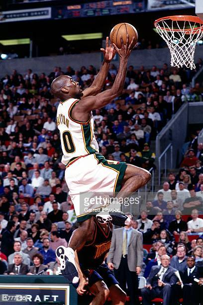 Gary Payton of the Seattle SuperSonics drives to the basket for a layup against the Golden State Warriors at the Key Arena during a 1999 season NBA...