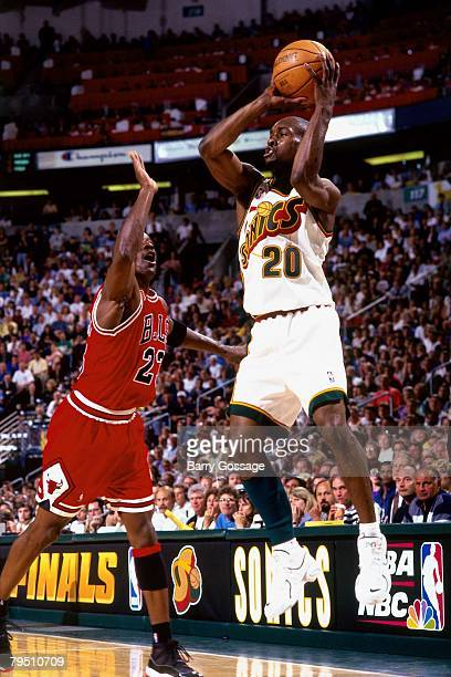 Gary Payton of the Seattle SuperSonics goes up for a shot against Michael Jordan of the Chicago Bulls in Game Four of the 1996 NBA Finals at Key...