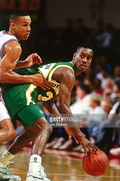 Gary Payton of the Seattle SuperSonics handles the ball against the New Jersey Nets during a game played at Brendan Byrne Arena in East Rutherford...