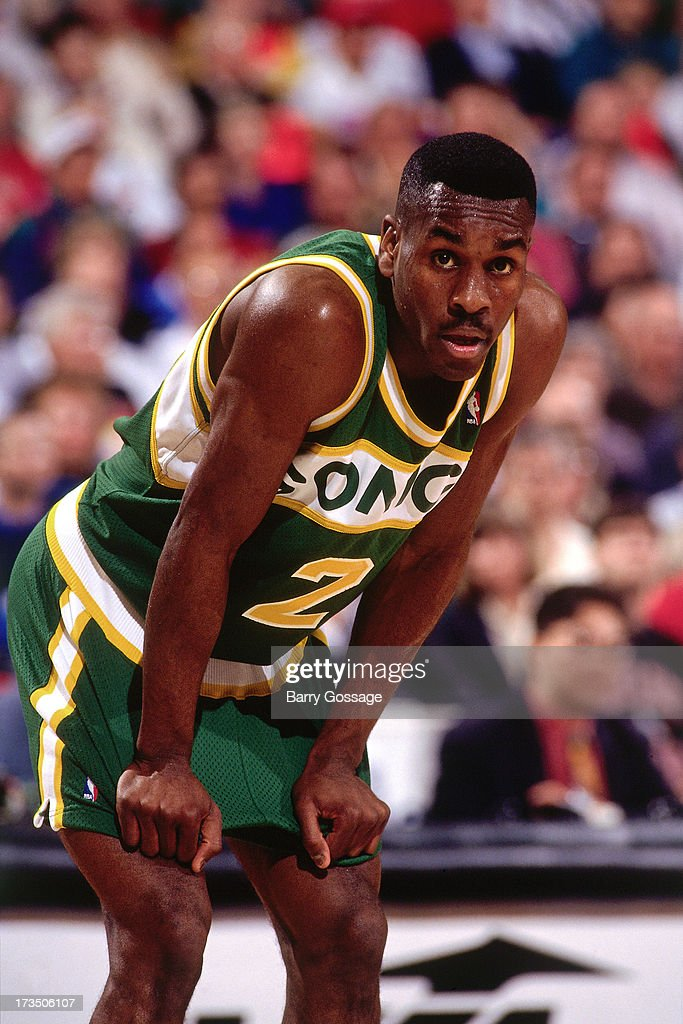 Gary Payton #2 of the Seattle SuperSonics looks on during a game played at the Seattle Center Coliseum in Seattle Washington circa 1991.