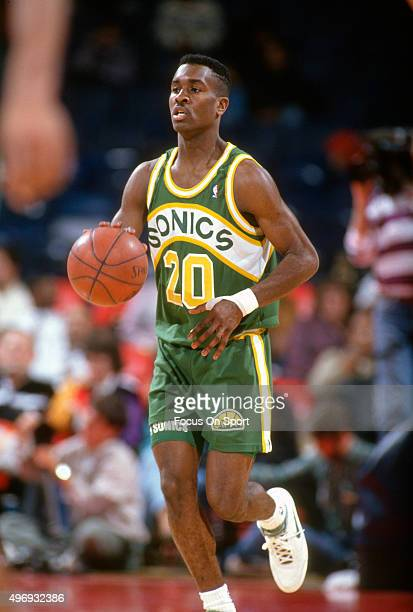 Gary Payton of the Seattle Supersonics looks to shoot against the Washington Bullets during an NBA basketball game circa 1991 at the Capital Centre...