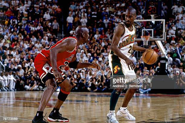 Gary Payton of the Seattle SuperSonics moves the ball against Michael Jordan of the Chicago Bulls in Game Five of the 1996 NBA Finals at Key Arena on...