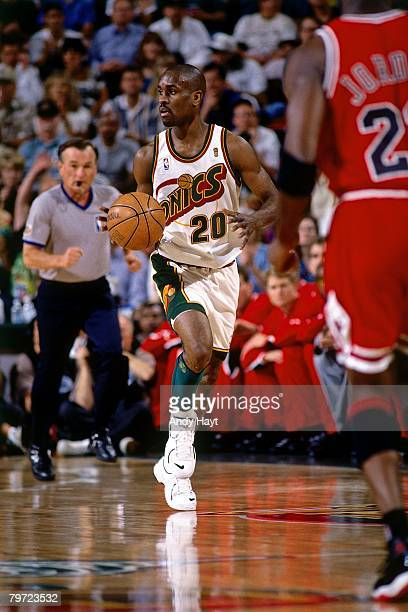 Gary Payton of the Seattle SuperSonics moves the ball up court against Michael Jordan of the Chicago Bulls in Game Five of the 1996 NBA Finals at Key...