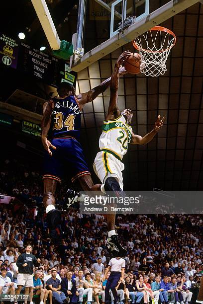 Gary Payton of the Seattle Supersonics shoots a layup against Brian Williams of the Denver Nuggets in Game Five of the Western Conference...
