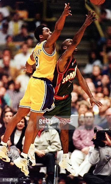 Gary Payton of the Seattle SuperSonics throws up a shot as he is guarded by Kobe Bryant of the Los Angeles Lakers during their 05 March game in Los...