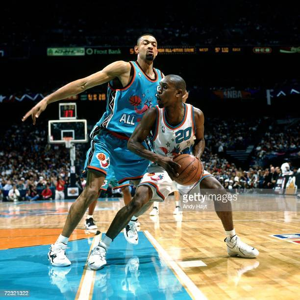 Gary Payton of the Western Conference All Stars posts up against Juwan Howard of the Eastern Conference All Stars during the 1996 NBA All Star Game...