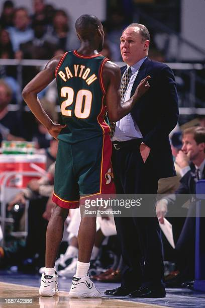 Gary Payton talks with Seattle Supersonics head coach George Karl against the Golden State Warriors circa 1996 at the OaklandAlameda County Coliseum...