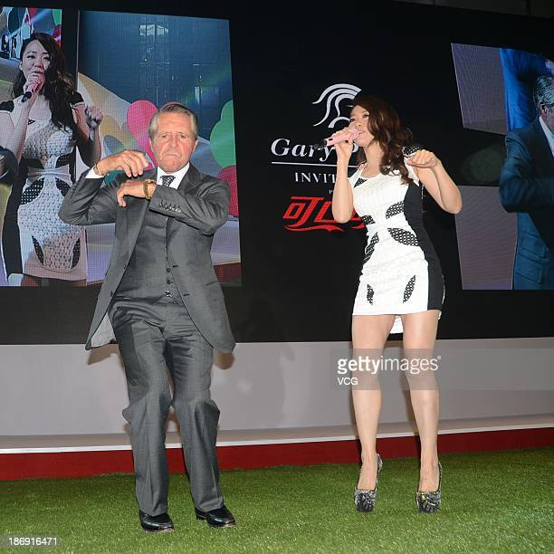 Gary Player and Chinese singer Zhang Liangying perform during Gary Player Invitational Charity Dinner at ShangriLa Hotel on November 4 2013 in...